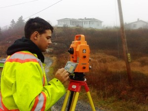 Man taking land survey measurements