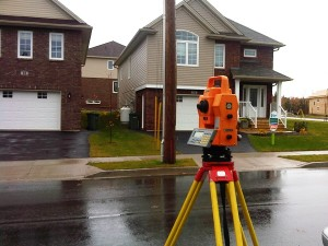 Land Survey Equipment in front of residential property